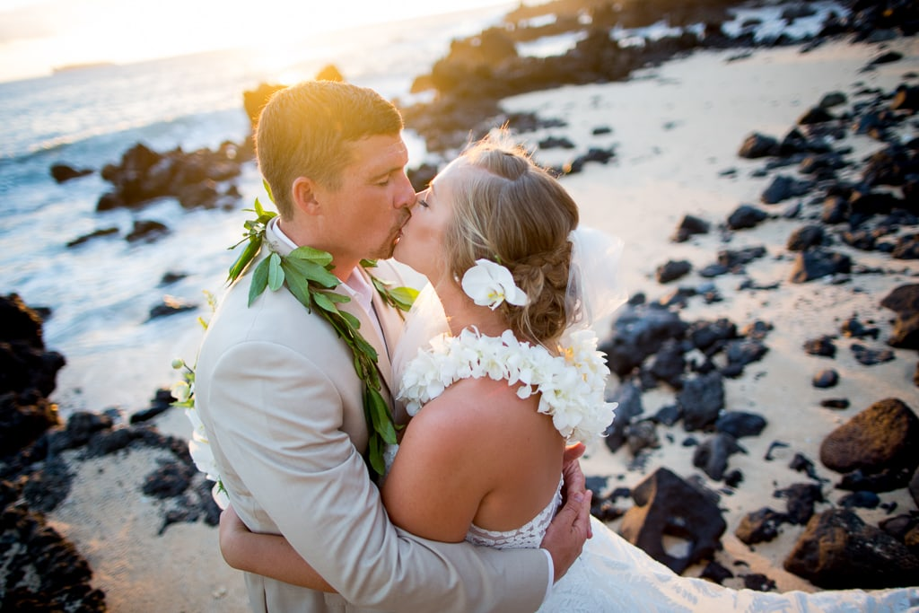 makena beach wedding kiss